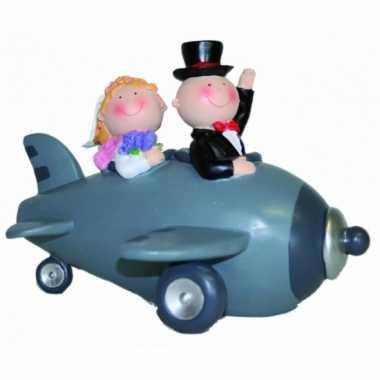 Bruidspaar in vliegtuig spaarpot